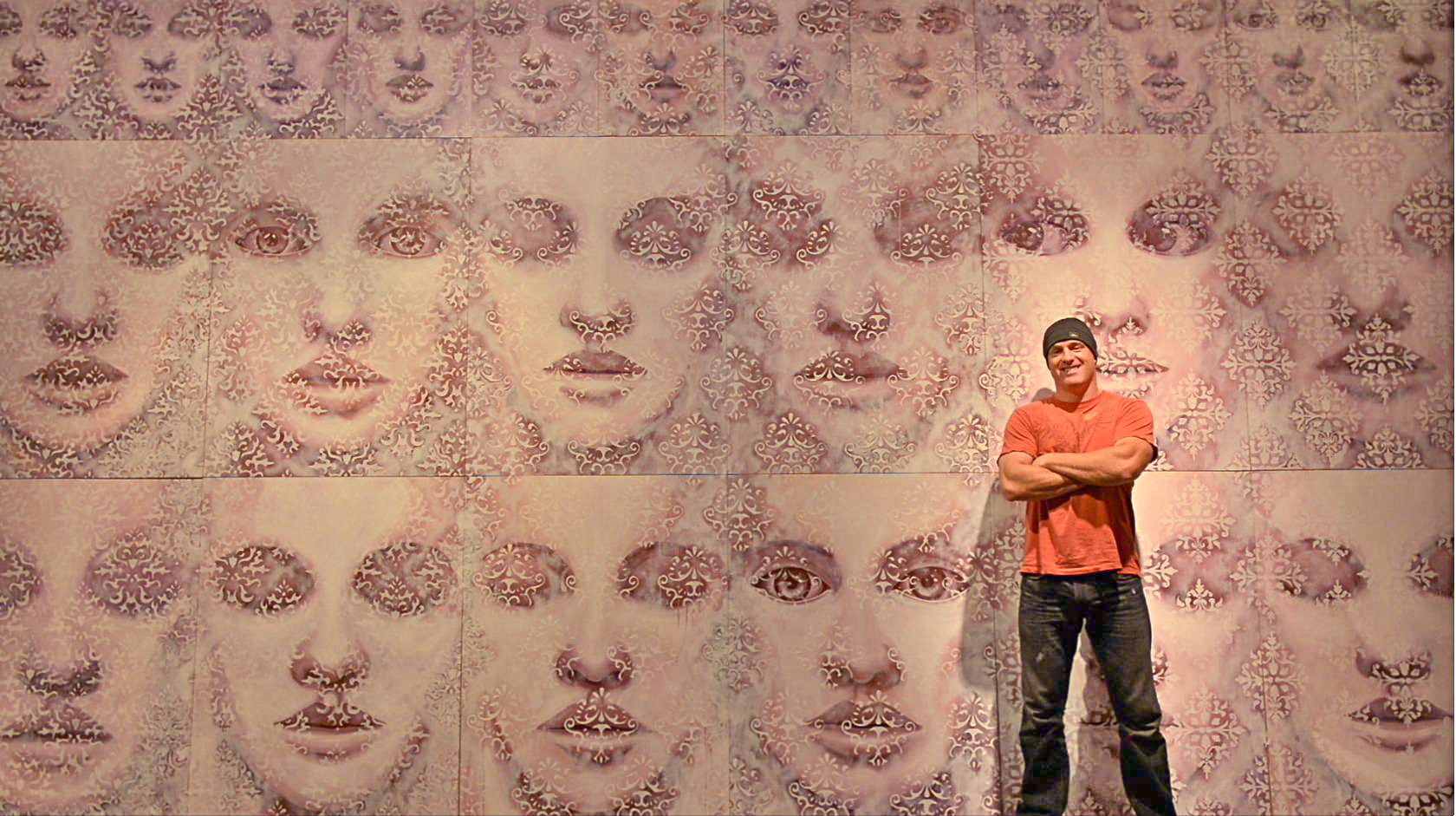 "Artist in front of ""The Best of Us"", 10 x 20 feet, from the ""Fade To White"" series."